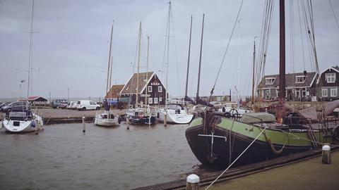 MARKEN, NETHERLANDS - DECEMBER 30, 2017. Walk along moored sailboats Bild