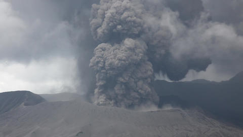 Dense ash cloud rising from Mount Bromo volcano, Java, Indonesia Live Action