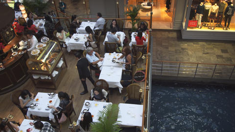 Luxury restaurant's dining room in the Shoppes at Marina Bay Sands Live Action