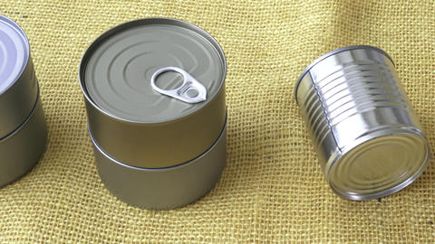 Canned food in cans on the yellow jute Footage