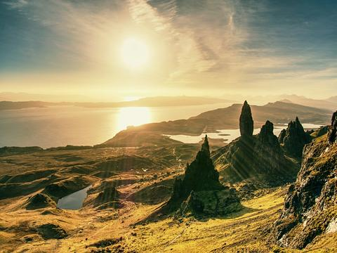 Morning view of Old Man of Storr rocks formation and lake Scotland Photo
