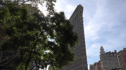 USA New York City Manhattan 5th Ave backlit shot of Flatiron Building Footage