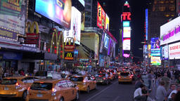 New York masses of yellow cabs on the 7th avenue Times Square by night Footage
