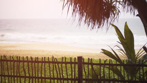 Tropical Beach Paradise from across a Fence in Hikkaduwa GIF