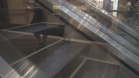 Escalator Steps Moving in Opposite Directions. Video 4k UltraHD Footage