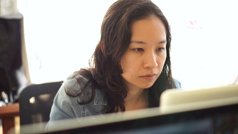 Asian woman girl working concentrated behind laptop computer Footage