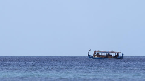 Wooden Tour Boat Cruising off Maafushi Island in the Maldives Live Action