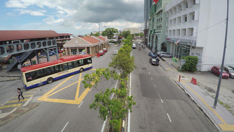 Typical traffic on a busy urban street in George Town. UltraHD 4k video Footage