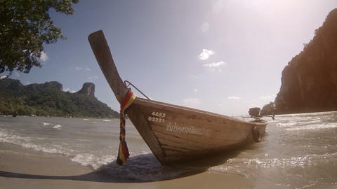 Thailand traditional wooden boat on a sandy beach without people Footage