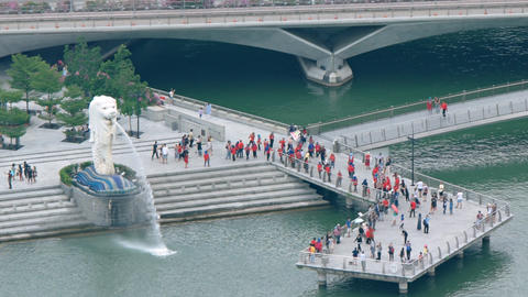 Visitors crowding on the pier in front of the Merlion fountain Live Action