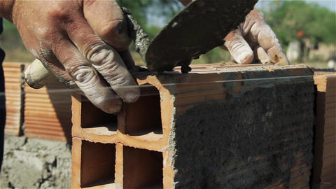 Worker with bricks Live Action