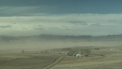 Dusty winds blowing past farm town Footage