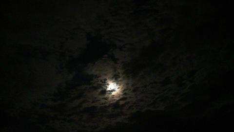 Moon behind cloud silhouettes Footage