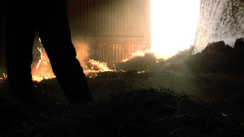 Farmer stacking straw in the hayloft Image