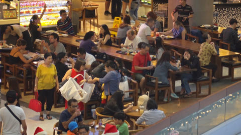 Guests break from shopping to enjoy a meal at Shoppes at Marina Bay Sands Footage