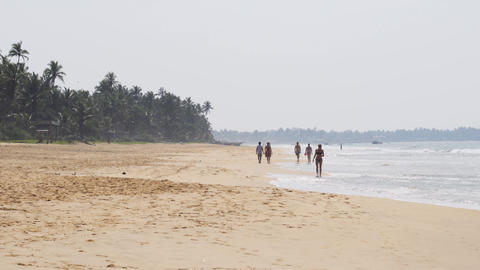 Visitors strolling on Hikkaduwa Beach. UltraHD 4k video Live Action