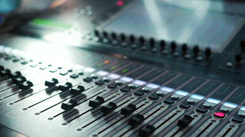Recording studios audio console and knob. Sound director records announcer Live Action