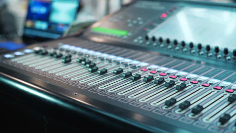 Audio mixer in a studio the automatic knobs moving up Footage