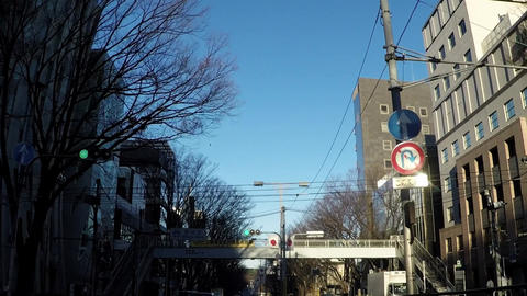 Japanese cityscape. A car window near Harajuku Omotesando Live Action