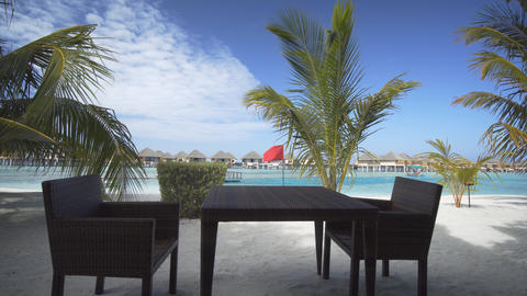 Table and Chairs for Seaside Dining at a Maldives Resort Footage