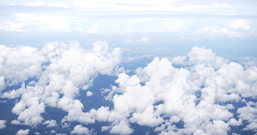 Puffy Clouds Below from Airline Passenger Perspective Footage