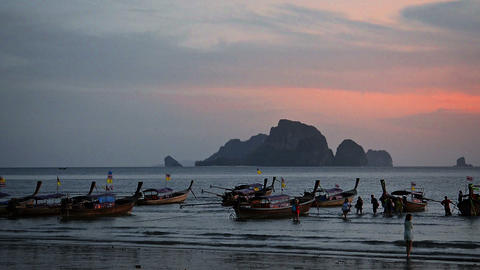 Thailand. Evening coast of ocean. Tourists returning from boating Footage