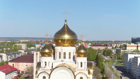 Shining Gold Domes on Church among Modern City Aerial View Footage