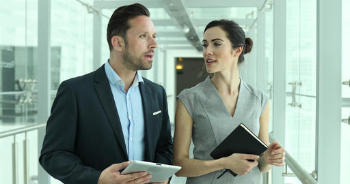 Relator showing new office space to businesswoman Live Action