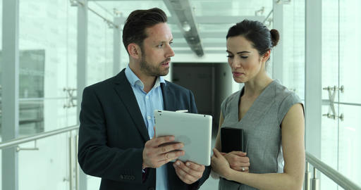 Business colleagues looking at digital tablet together Footage