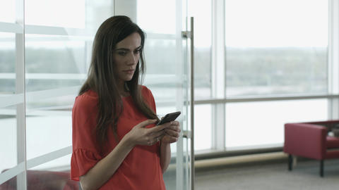 Female executive using smartphone waiting for a meeting Footage