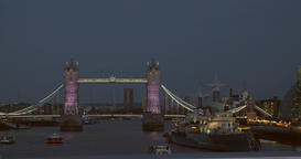 Tower Bridge at night with people walking through Footage