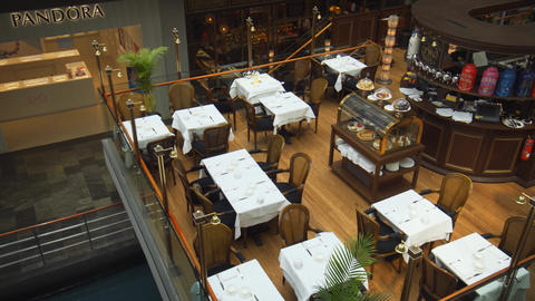 Elevated view of a fine dining restaurant in the Shoppes at Marina Bay Sands Footage