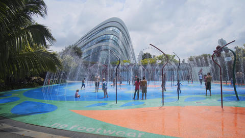 Kids playing at Gardens by the Bay's childrens' water park Footage