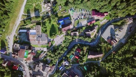 Mountain village. Flight in the mountains. Dombayskaya Polyana, Footage