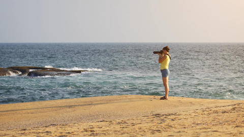 Woman Photographing Sri Lankan Oceanscape from Sandy Beach Footage