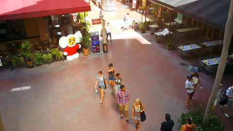 Security camera perspective of a courtyard at Jungceylon Shopping Center Live Action