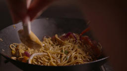 Stirring Noodles in Wok spaghetti cooking Filmmaterial