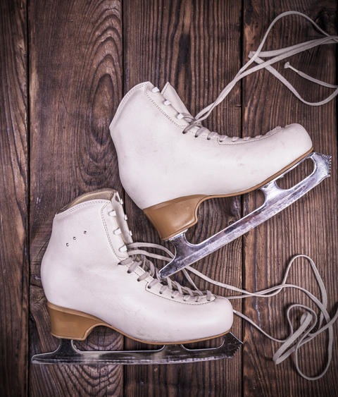 female white leather skates for figure skating Fotografía