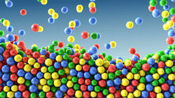 Colorful chocolate candies coated shiny balls blue background texture pattern Animation