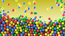 Colorful chocolate candies coated shiny balls yellow background texture pattern Animation