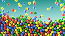Colorful chocolate candies coated shiny balls green background texture pattern Animation