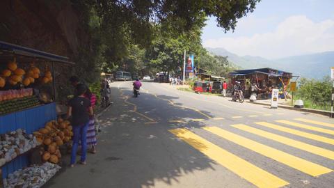 Road near Ravana Falls. Sri Lanka. Local sell coconuts and souvenir stones Live Action