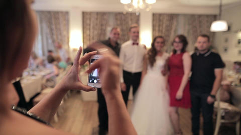 SUMY, UKRAINE - AUG 04, 2017: Woman photographs guests and newlyweds on a Footage