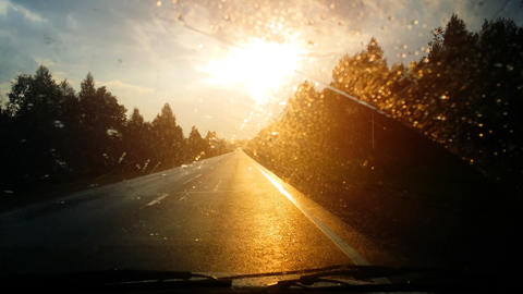 Driver's Perspective of Rain and Sunset on the Highway. UHD 4k video Footage