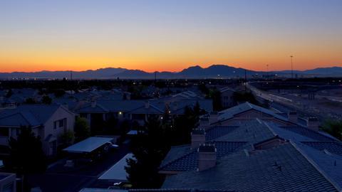 Time lapse sunrise over residential neighborhood Archivo