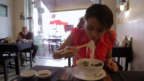 Asian girl eating noodle Footage