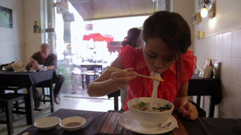 Asian girl eating noodle Stock Video Footage