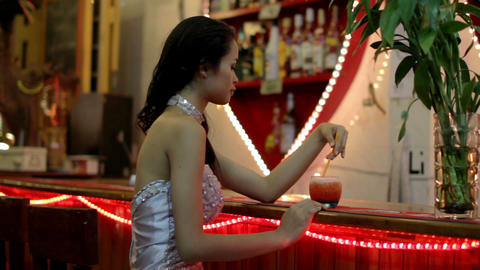 gorgeous asian woman alone at bar Live Action
