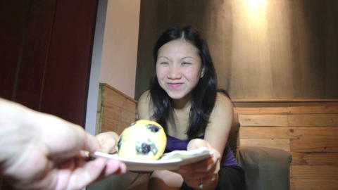 Young asian woman fights for cake Stock Video Footage