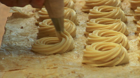 german bakery squirt dough on sheet 2 10755 Stock Video Footage